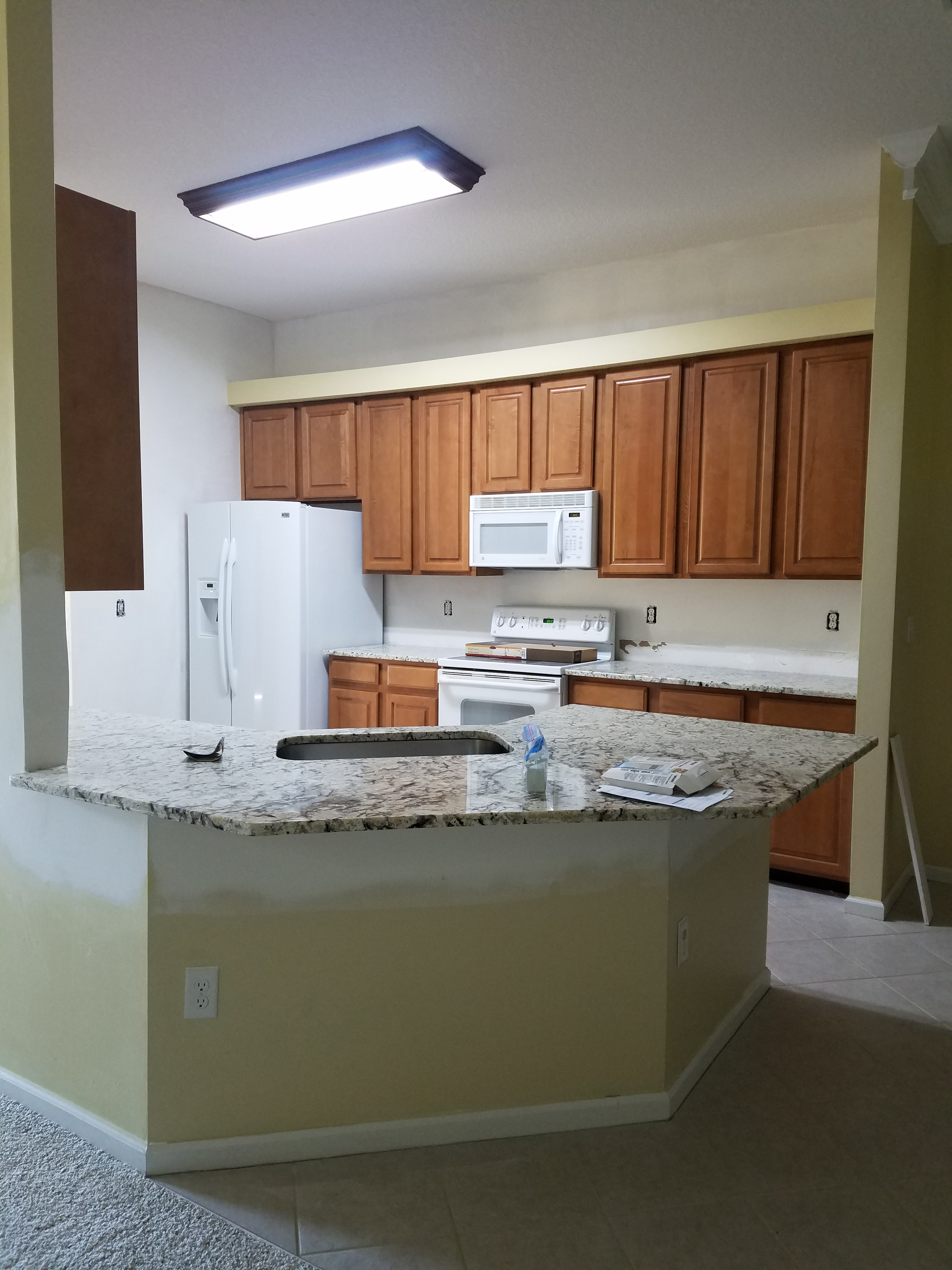 Cabinet staining and refinishing in st john s county for Catalyzed lacquer kitchen cabinets