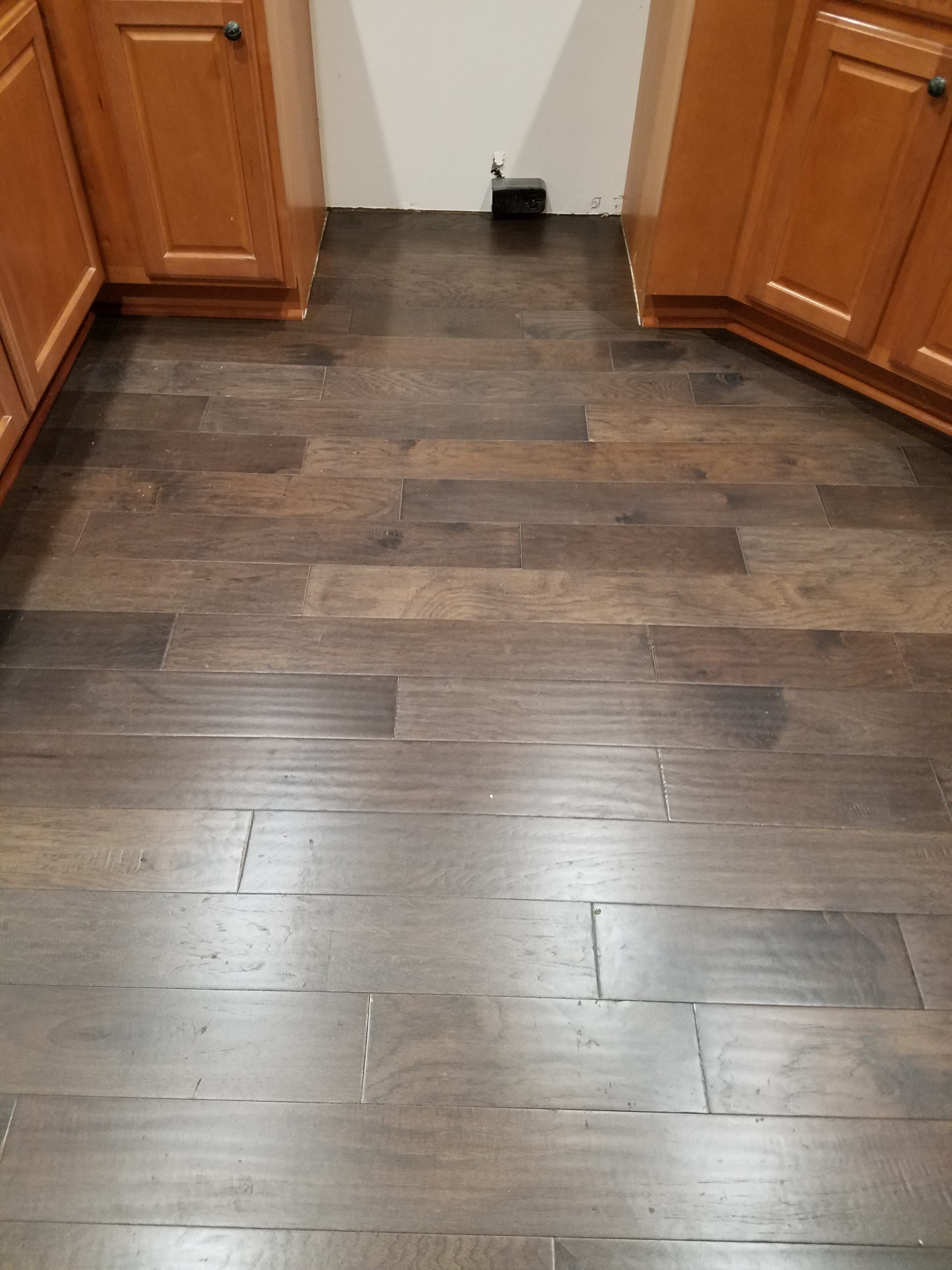Engineered hardwood glue down installation on the southside for Hardwood flooring 78666