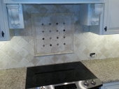 AAA completes Custom Kitchen Tile Backsplash Over Stove